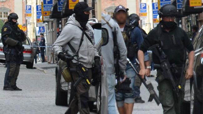 Tungt beväpnade polisoperatörer som deltog vid gripandet av den misstänkte bombmannen i Gamla stan, sommaren 2014. Foto: Christoffer Jonsson