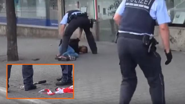 Här griper polisen asylsökaren. Foto: Faksimil Youtube.